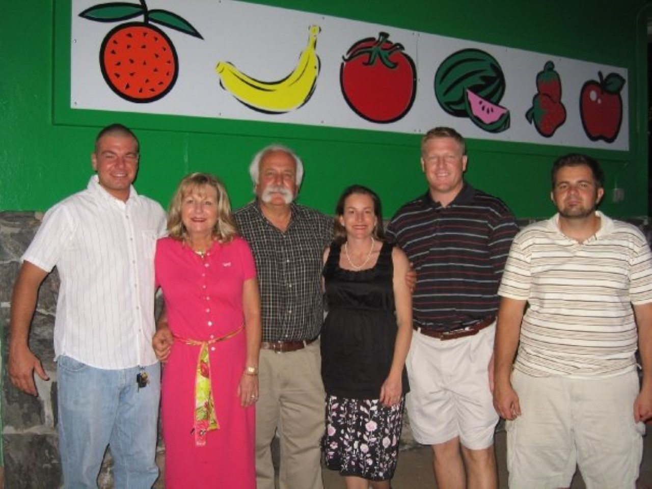 Our family posing for a picture in front of our new store Tampa Bay Farmers Market opening May 2009